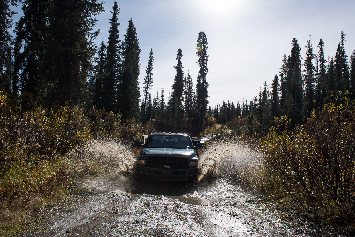 Pickup truck driving through mud in the Yukon