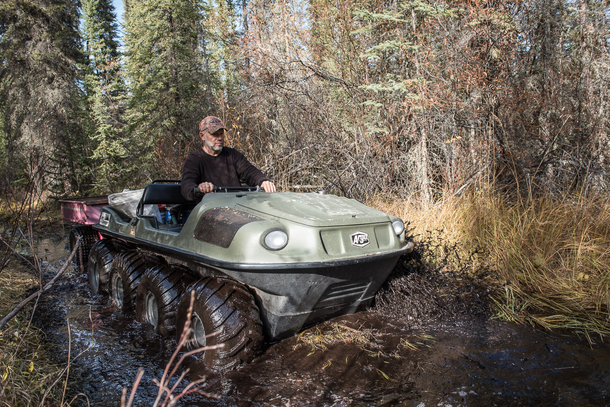 Argo driving through mud in Yukon
