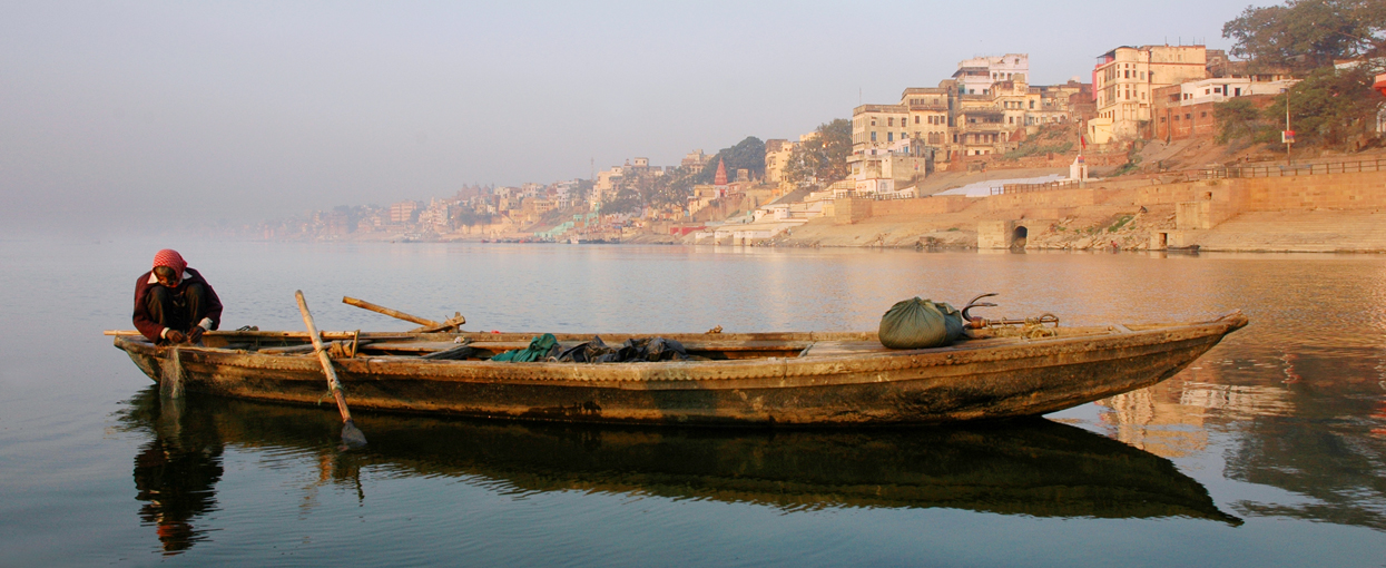 fisherman on ganges in Varanasi early morning